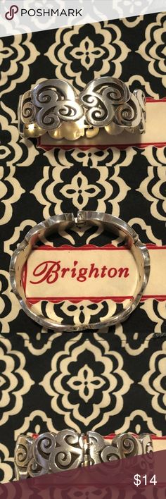 "EUC Brighton Bracelet This Mingle Me hinged bangle features a continuous scroll pattern that is contemporary yet timeless!  It looks equally stunning with your casual or dressy outfits.  1"" wide; 2-3/4"" diameter; magnetic hinge closure; silver plated. Brighton Jewelry Bracelets"