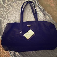 Authentic Black vela sport Prada bag Lightly used, was a gift never really wore, in great shape large bag Prada Bags Totes
