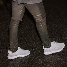 "#firstlook: @adidasoriginals Yeezy 350 Boost ""Silver"" worn by Kanye West at last night's @alexanderwangny #nyfw show and after-party."