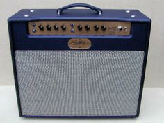"""FASTBACK 22 Watt 1x12 Combo   Fastback Guitars in Seattle is offing one of the last Fastback combo amps built and designed by Kracke Amplification. This 22 watt combo amp that has a half power switch to 10 watts is loaded with a 1x12 Weber Silver Bell 30w Alnico speaker. The Silver Bell 12"""" (British Tone) ~ Big low end, compressed high volume rock and roll tone, reminiscent of the classic Marshall stack tone, hand made in Kokomo, IN. Stocked with 1970 N.O.S. 6V6 tubes, 100% hand wired."""