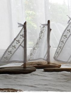 lace and driftwood sailboats