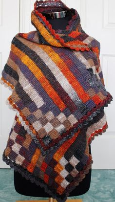 Crochet pattern for a Stripy Entrelac wrap using a simple tunisian stitch and a standard crochet hook.