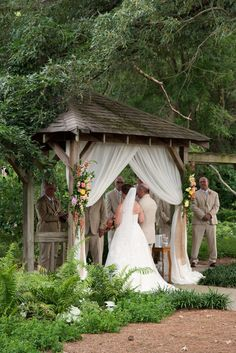 Gazebo with draping and flowers - Colorful Coral and Yellow Norfolk Botanical Garden Wedding Ceremony in