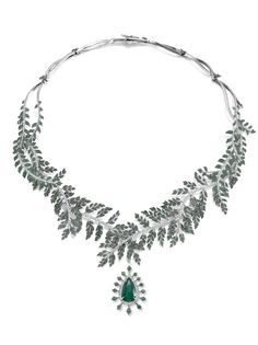 The Fern Necklace with fern branches and leaves hinged and intertwined, set with emeralds and diamonds leading to a removable emerald and diamond pendant, set with a pear shaped emerald, suspended within a diamond frame. All set in platinum with black rhodium highlights