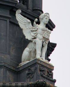 Female sphinx on the tower of the Town Hall of Paris.