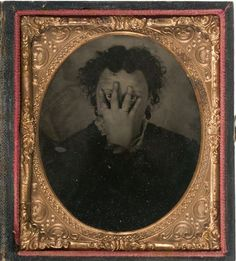 ca. 1860-90s, [unusual tintype portrait of a mysterious sitter peering through their fingers] via Cowan's Auctions