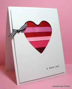 Wonderful use for your ribbon scraps on this handmade valentines card.  Layer them under a cutout heart and use foam tape to add dimension.  The ribbons can be solids in any colors you choose or they can be patterned.