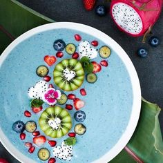 Hi there Blue Coconut Protein Smoothie Bowl. 1 frozen banana scoop Coconut Milk Power Plant Protein 1 small zucchini peeled and chopped Pinch of Spirulina powder Ice cubes Check Out More Smoothies Please! Apparel Store with cool stuff Link in Bio! Fruit Smoothies, Healthy Smoothies, Smoothie Recipes, Healthy Snacks, Healthy Eating, Healthy Recipes, Vegetarian Recipes, Smoothie Breakfast, Breakfast Bowls