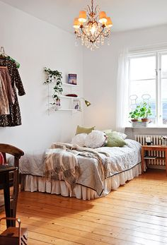 corner bed, dust ruffle + lots of pillows