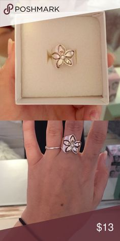 Flower Ring Silver flower ring with tiny gem in the center. Comes in original packaging. Premier Designs Jewelry Rings