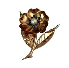Charming Marcel Boucher mechanical flower brooch. Petal can be moved so flower is closed or open. Set with colored pastes and faux pearl. 1950's