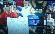 Sibling love. | 32 Hilarious Fan Signs That Deserve Their Own Standing Ovation