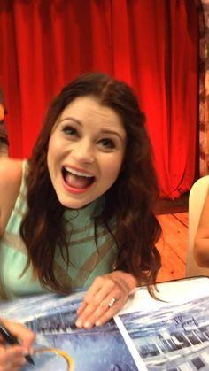 Emilie de Ravin poses for a photo while signing autographs at Comic Con 2014