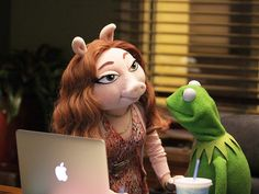 Muppets in the News.   Kermit the Frog & his new girlfriend, Denise.   I think she looks kind of young for him.