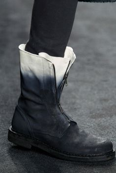 Some days, when I need a break from heels, I wish I had boots as cool as these! Ann Demeulemeester of course. I saw her last spring while shopping in Colette, Paris. Totally stalked her.