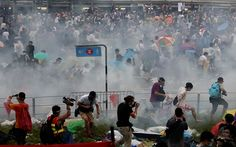 People disperse after police fired tear gas upon pro-democracy demonstrators near the Hong Kong government headquarters