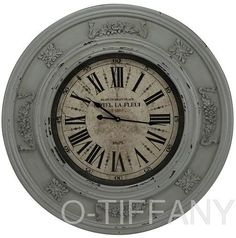 Place a clock inside a ceiling medallion...DIY. (Of all the clocks I've seen thus far using ceiling medallions, me likes this one the best).