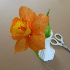 """The daffodil is a favorite spring flower which comes in a variety of color combinations. Make the stamen from twisted crepe paper. To achieve the tipped look often found on these early spring flowers, dip the finished """"bell"""" in food coloring."""