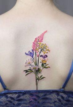 Cindy Vanschie flower tattoo