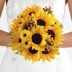 This sunflower wedding bouquet includes viking pomps, which look rather like a black-eyed Susan daisy. Soft peach hypericum berries and a little bit of feathery solidego give just the right finishing touch!