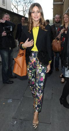 Olivia Palermo paired Topshop floral pants with a neon sweater and blazer to the Unique runway show