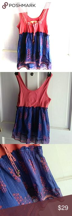 Free People Tank Cute tank top is burnt rustic orange and the bottom is navy blue with floral accents. With high- low feature. Tasseled with gold balls. 100% cotton.  BUNDLE & SAVE$$$!!! Free People Tops Tank Tops