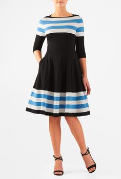 Our retro dress beautifully recaptures ladylike poise in a banded stripe stretch-jersey with a high boat neckline and a nipped-in waist. The swishy flared skirt has discreet pockets and hits at the knee.