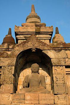 ^Borobudur Buddha . Central Java, Indonesia