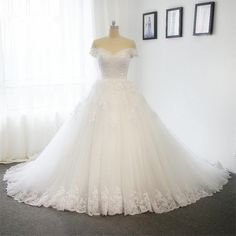 Off the shoulder ball gown A line wedding