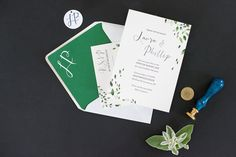 Mikkel Paige Photography photos from a Southwood Estate Wedding in Germantown, New York in the Hudson Valley. Picture of the invitation suite with green and white details.