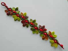 Handmade Green & Red Beadwoven Bracelet Leaf Wrap Bracelet Summer Bracelet Vintage Style. £28.00, via Etsy.