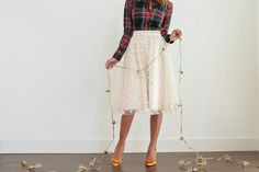 nice, fun mix. plaid shirt, dots tulle skirt, tights, and yellow bow heels