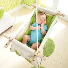 Easy-to-make hammock for babies. This would be a unique idea for a baby shower- especially when the momma has had so many showers that there isn't much left on her registry. I'd fill it with other items so it would serve as a gift basket, too. I want one of these!!!