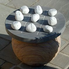 An outdoor tic tac toe table