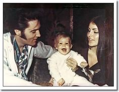Elvis and Priscilla Presley at home with baby Lisa Marie