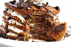 The most sensational Oreo Pancakes Recipe (or Cookies and Cream Pancakes) you have ever witnessed... or tasted! Chocolate pancakes get updated with oreos, whipped cream and chocolate sauce!