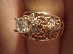 A super close-up of my engagement ring. It's yellow gold filigree with white gold accents and lots of diamonds.