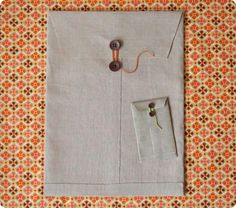 DIY - Cloth envelope. Better to have a hard board on the back before gluing the cloth. Good idea for packaging of large prints.