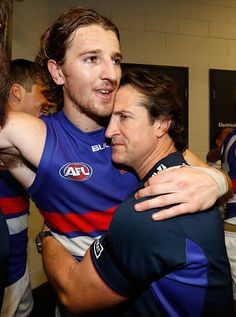 Marcus Bontempelli and Luke Beveridge Senior Coach of the Bulldogs celebrate during the 2016 AFL First Preliminary Final match between the GWS Giants...