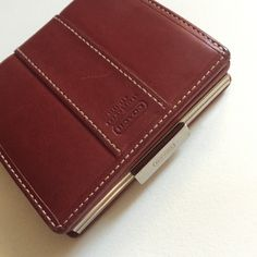 Authentic Coach Wallet in deep red Preloved condition. No rips or tears. Silver metal and deep red leather. Medium sized wallet. Some scratches and small stains, see photos. Coach Bags Wallets
