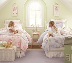 pale green wall color, white furniture, and flower accent table for Maggie's big girl room