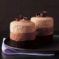 Make Gluten Free > Triple-Chocolate Mousse Cake Recipe. The dark-chocolate cake at the base is baked in ramekins. Two layers of plush, pillowy mousse -- bittersweet and milk chocolates -- are piped on top and capped with semisweet chocolate curls. Triple Chocolate Mousse Cake, Dark Chocolate Cakes, Chocolate Recipes, Chocolate Curls, Delicious Chocolate, Choc Mousse, Chocolate Smoothies, Chocolate Shakeology, Lindt Chocolate