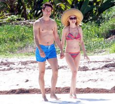 Ageless actress Heather Graham has been dating The Bachelor Canada host Tyler Harcott for a year, Us Weekly can exclusively confirm; check out the couple's amazing beach bods during their vacation in Tulum, Mexico