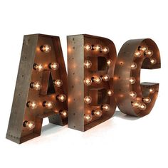 "Marquee letters...  This listing is for ONE 18"" tall illuminated marquee letter. Each letter is handcrafted of steel, a brown patina, and a clear"