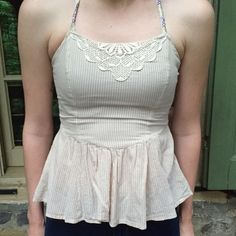 Beige striped Halter top with embroidery-HP 6/20🌸 Sand colored and pin striped shirt with gorgeous embroidered halter straps. The front detailed design makes the shirt. Fits like an XS or small, labeled size 2 in Free People. It is a little small on the model in the SECOND pic as you can probably tell. peplum fit. Preloved in EUC. Always love to negotiate and price drop! YES I do bundles. No trades please🚫🚫 ⚠️note: this shirt is too small on MY model she is usually a medium, not a size 2…