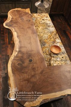 Natural wood countertops crafted from reclaimed or salvaged live edge burl wood slabs. Solid tree slabs - burl wood slabs - live edge wood countertop for the basement bar in the mountain house