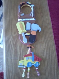 I held a construction baby shower theme for my girlfriend and made him a door hanger using items from Michaels.