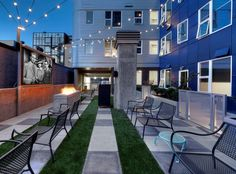 A serene 3,600-square-foot sky deck including outdoor entertainment facilities with a green roof, and theater at AMLI South Lake Union, luxury apartments in Seattle.
