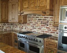 Kitchen Backsplash Brick Look pot-filler is a must-have in a cook's kitchen. the dark metal
