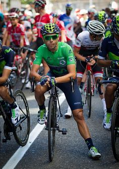 Movistar's Spanish cyclist Alejandro Valverde sits on his bicycle before the…
